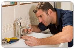 Plumber repairing lav faucet