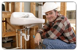 Plumber next to finished lavatory plumbing